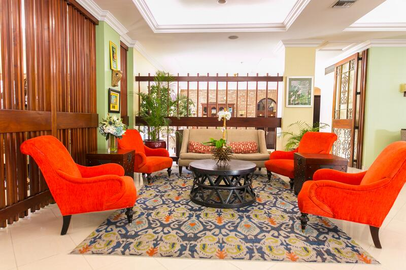 living room with bright chairs