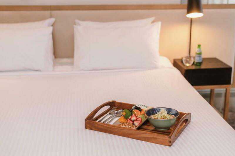 Brady Hotels Central Melbourne room service on bed