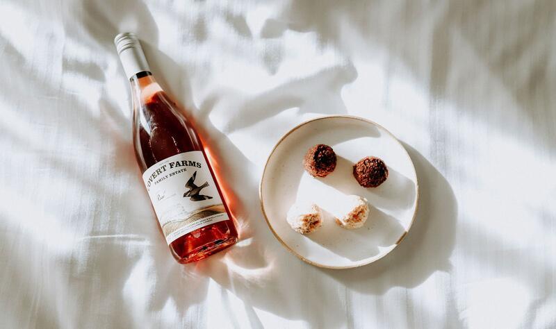 Photo of wine and bitesize cookies.