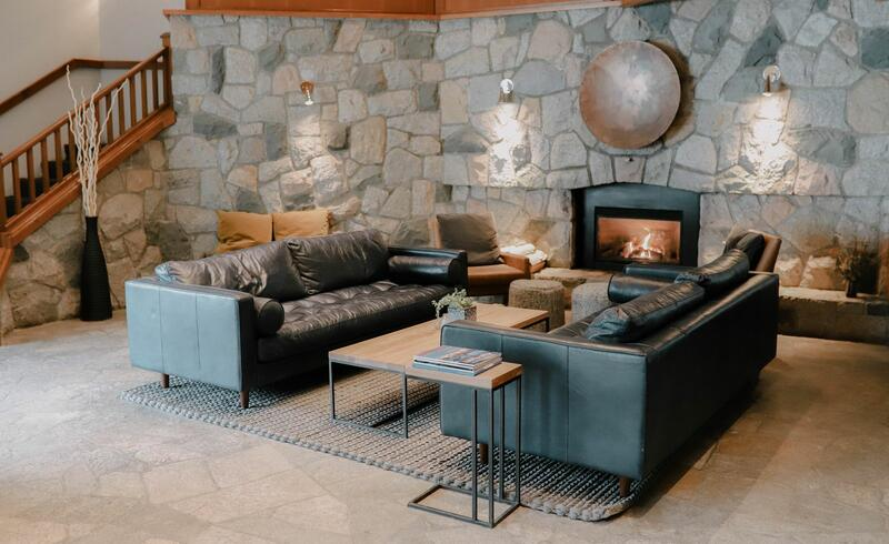 Rustic luxury hotel lobby with fireplace.