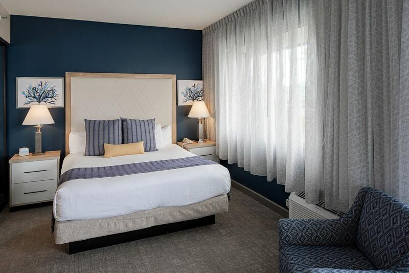 Comfy hotel bed in hotel room window curtains for privacy