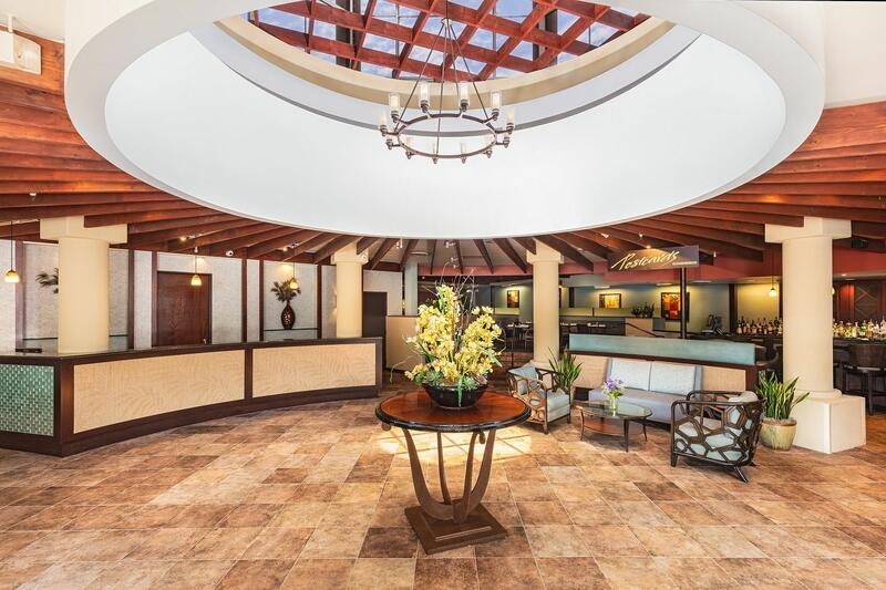 lobby with decorative table and chandelier in the middle