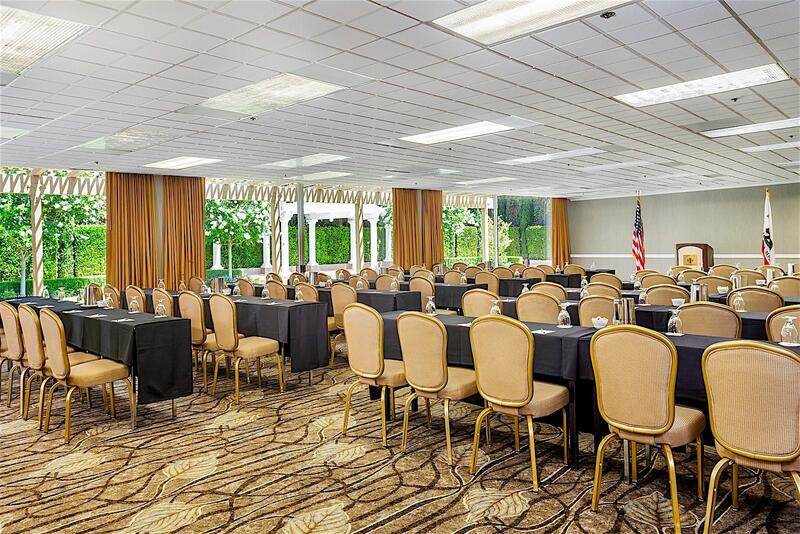 ballroom with tables and chairs set for conference event