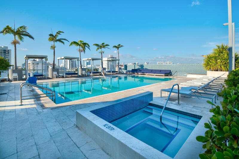rooftop pool and jacuzzi with city view