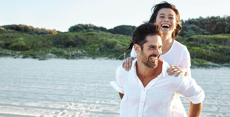 Smiling couple on the Beach near Silkari Port Douglas Hotel