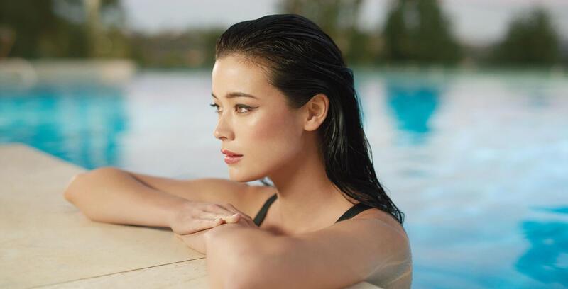 Woman by the Pool at Silkari Port Douglas Hotel