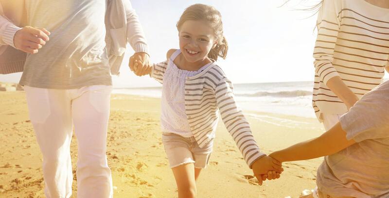 Family Holding Hands on the Beach near Silkari Port Douglas Hote