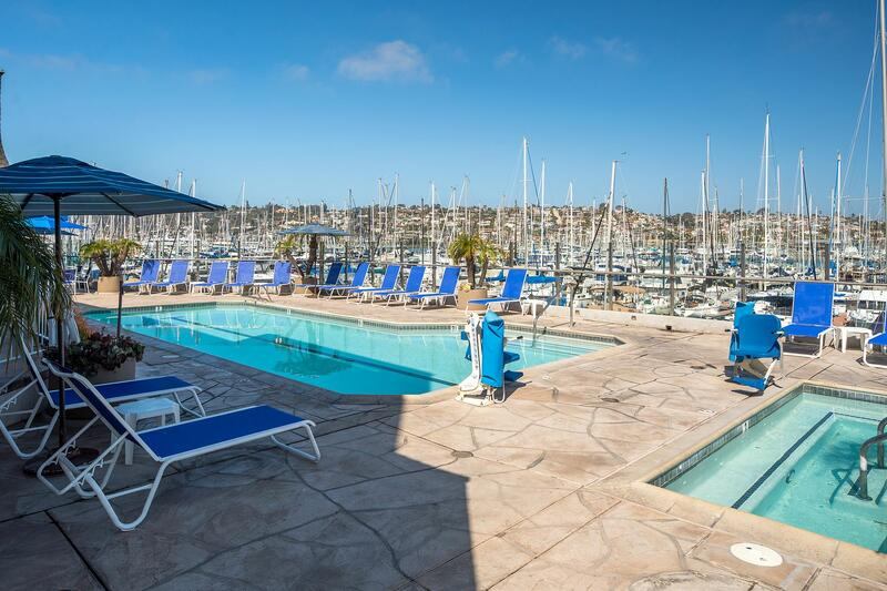 Outdoor pool and hot tub right next to a marina on the San Diego