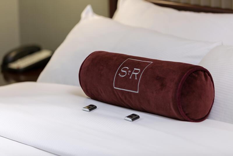 Branded hotel bolster pillow.