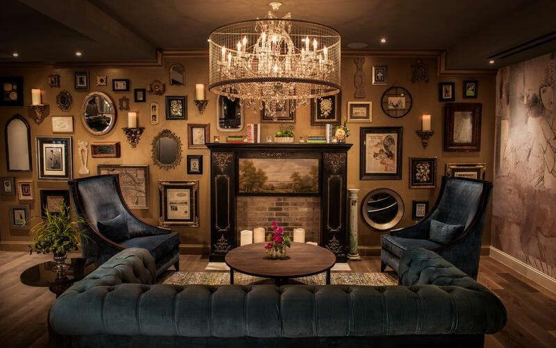 antique lounge area with sofa and wall art