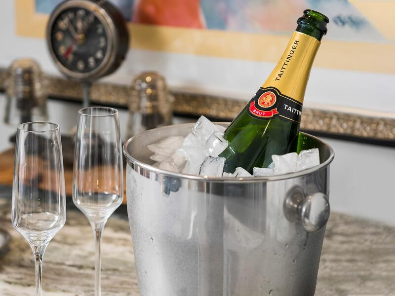 champagne bottle in bucket of ice