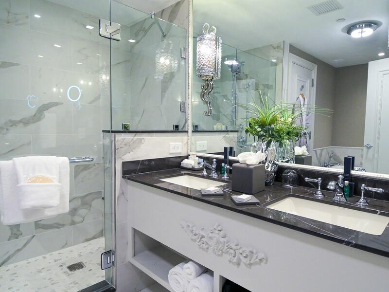 bathroom with mirror, sink and shower