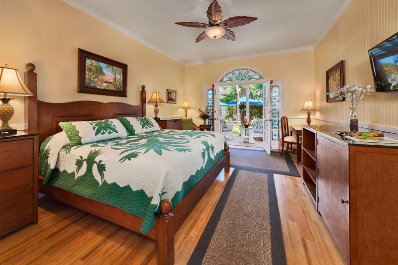 green bed in tropical bedroom