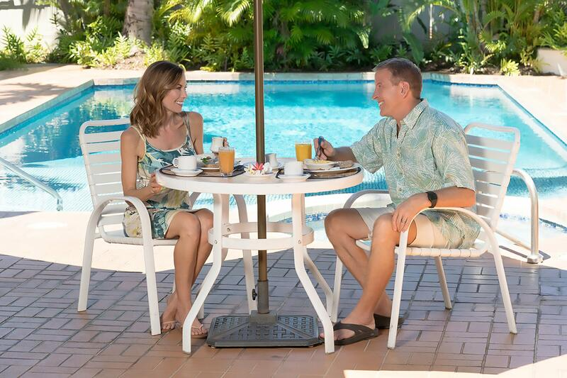 couple drinking coffee by pool