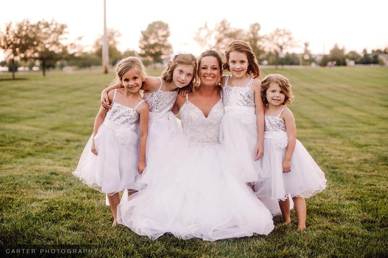 a bride hugging her children