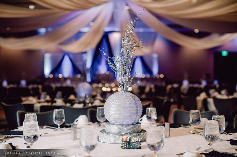 tables and chairs in a wedding ballroom