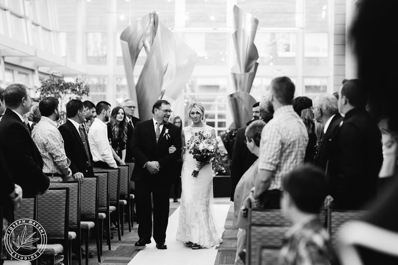 a father walks his daughter down the isle
