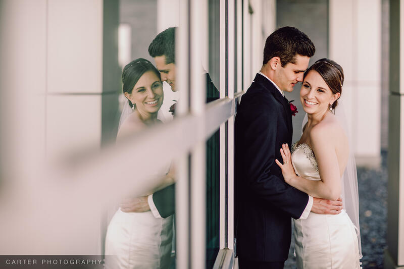 a bride and groom holding eachother