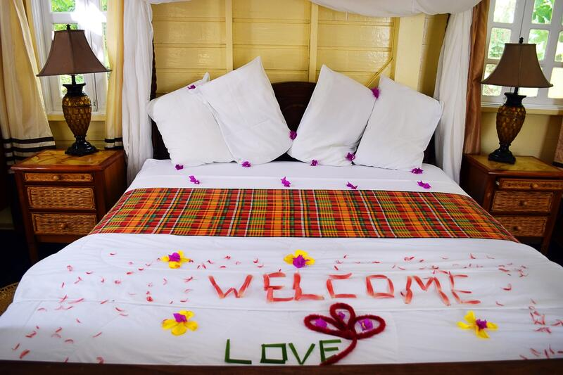 bed with honeymoon decorations that says welcome love