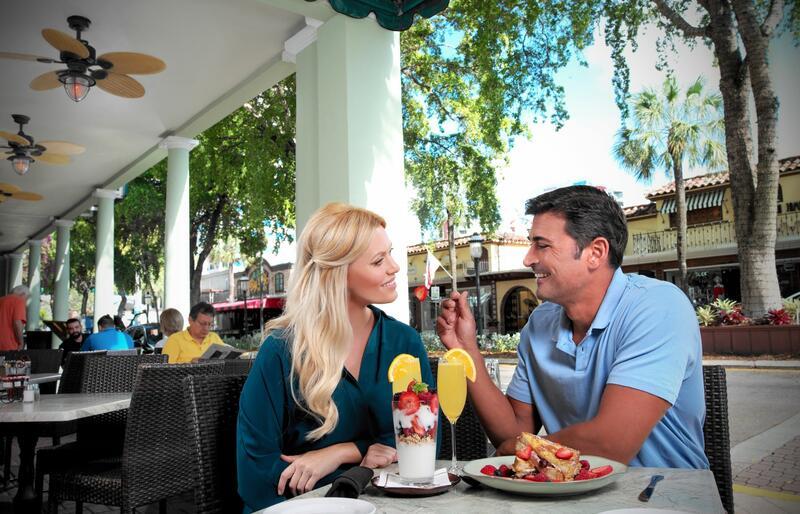 couple eating breakfast on restaurant patio