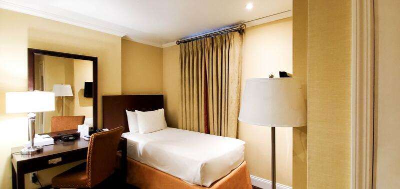 Single bed in hotel room