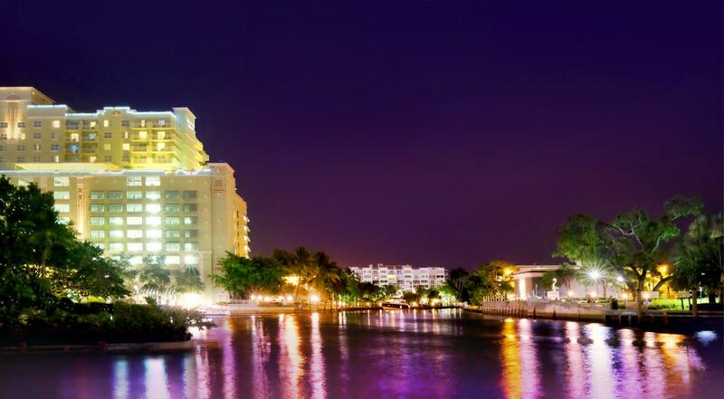 lit up hotel on river at night