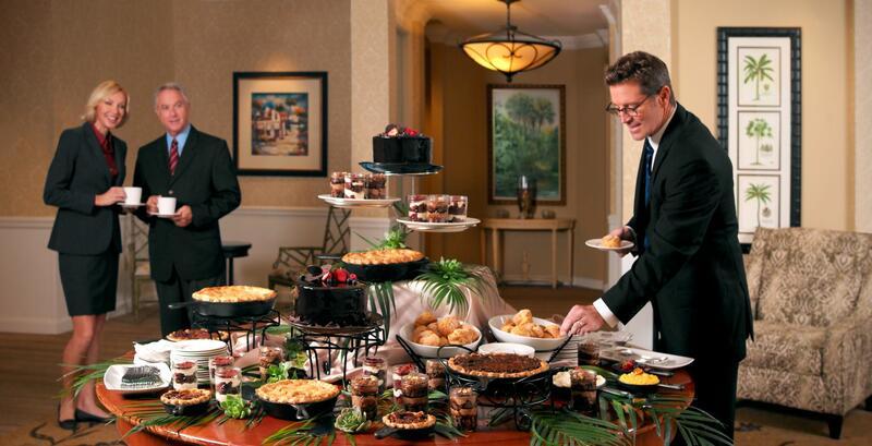 business people taking dessert