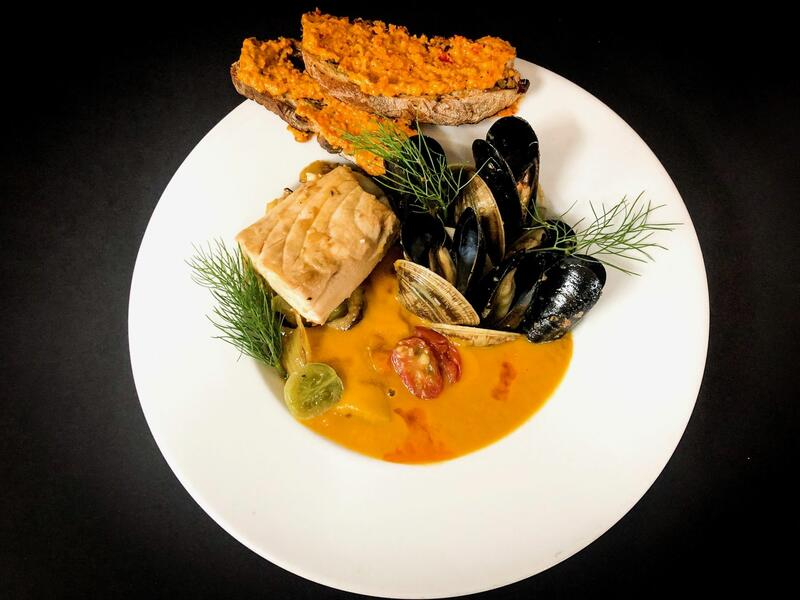 seafood plate with clams and sauce
