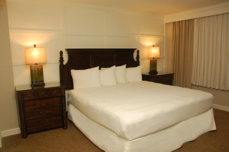king bed with white sheets