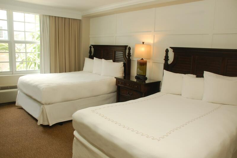 two beds with white sheets