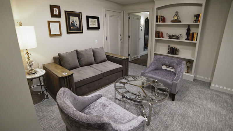 suite with couch and cozy carpet