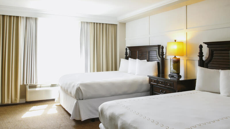 two white beds in hotel room