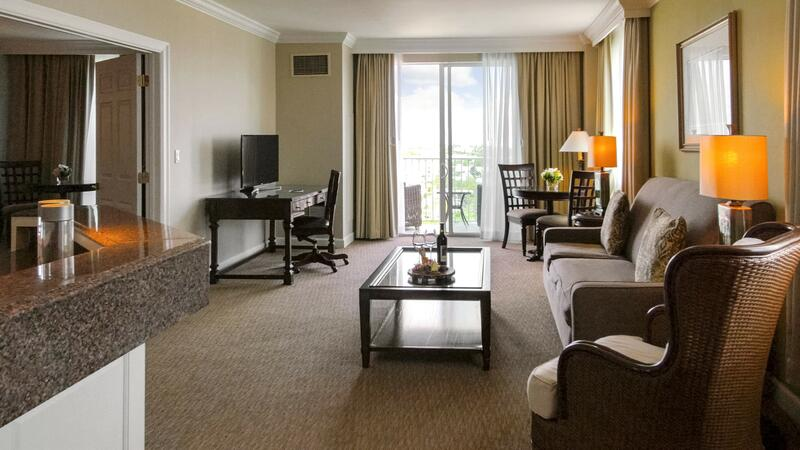 hotel suite with couch and tv