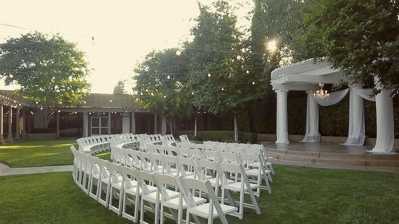 garden area set with chairs in front of gazebo