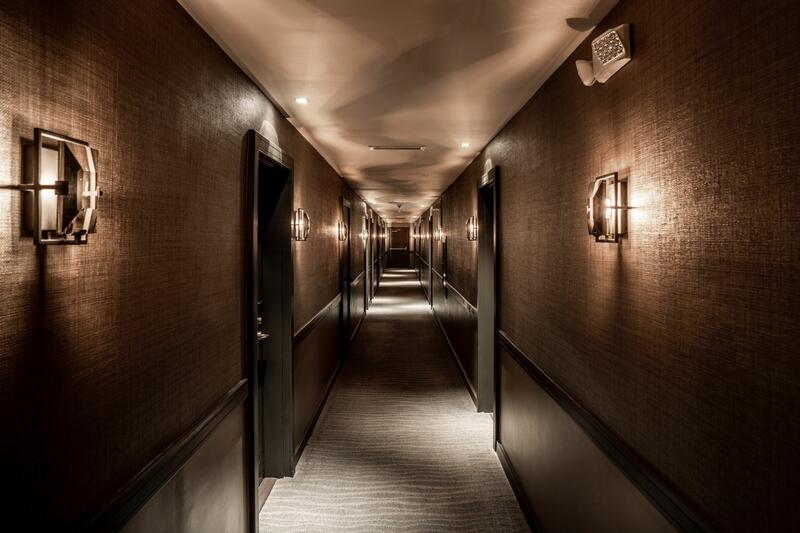 dim hallway with light on wall