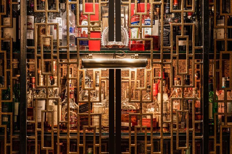 alcohol bottles behind fancy bars