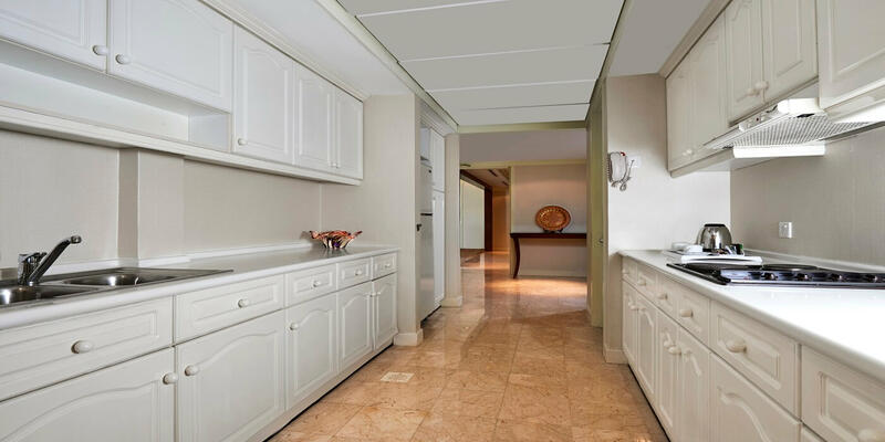 Spacious kitchenette with white cabinets