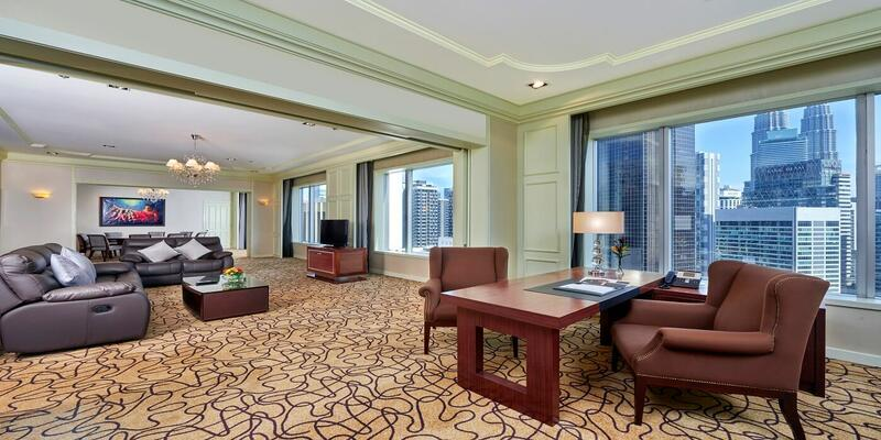 Living area of presidential suite furnished with couches and sep