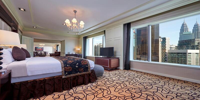 Bedroom of presidential suite with views of KLCC