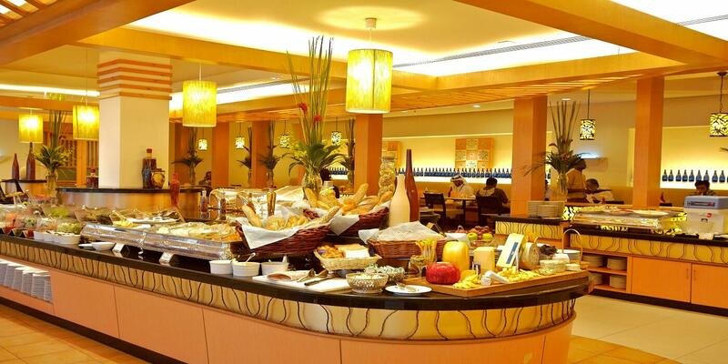 Buffet spread at Taman Saru Brasserie with a couple of diners in