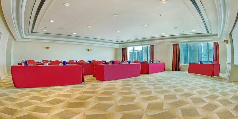 Function room with rows of tables and chairs