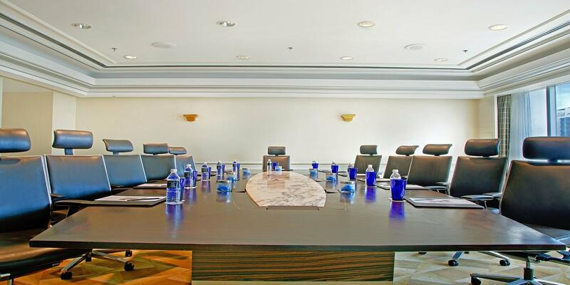 Function room with long rectangle table and chairs surrounding i