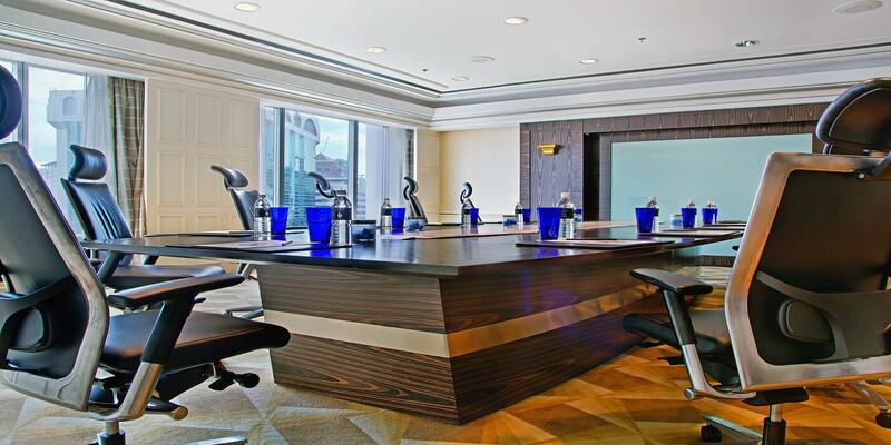Meeting room with a long table and chairs surrounding it