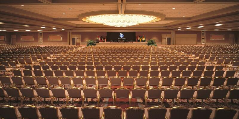 A ballroom filled with rows of chairs