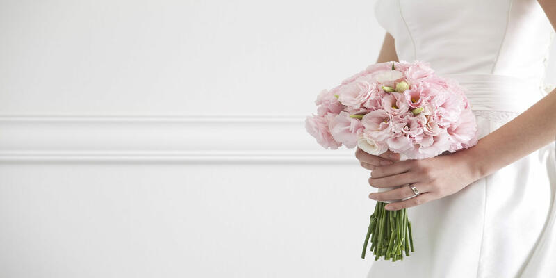 A lady holding a bouquet of flowers