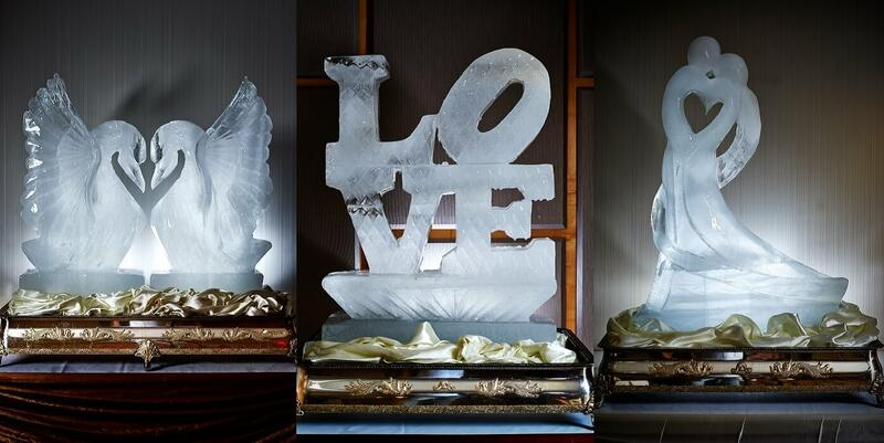Ice carvings of a couple, swans and the word 'love'