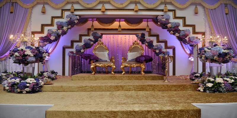 Wedding set up that showcases purple lights and flowers