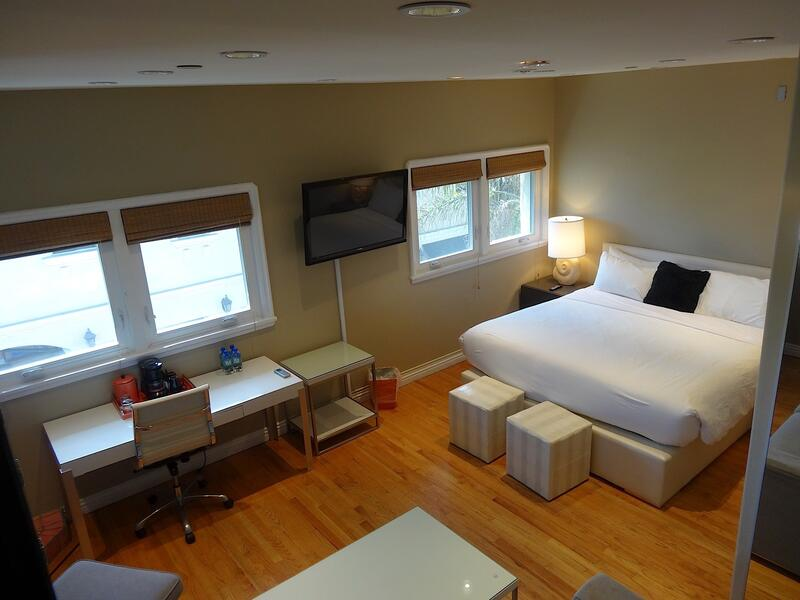 overhead view of king bedroom with flat-screen tv and desk