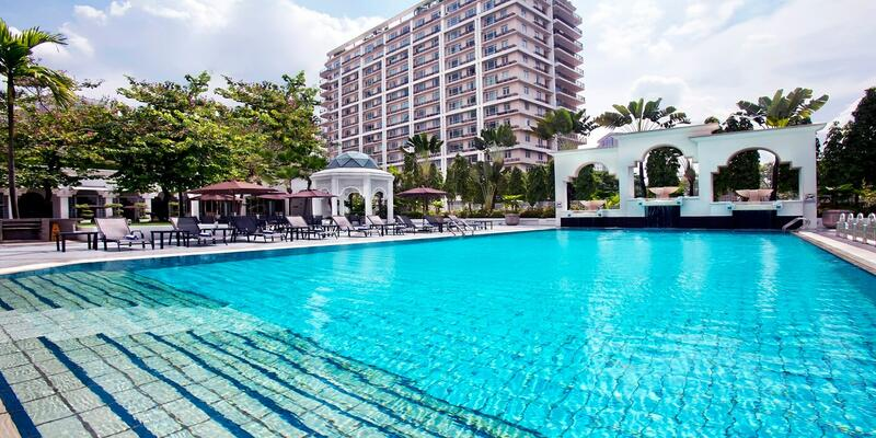 Hotel Istana KL's swimming pool with buildings in the background