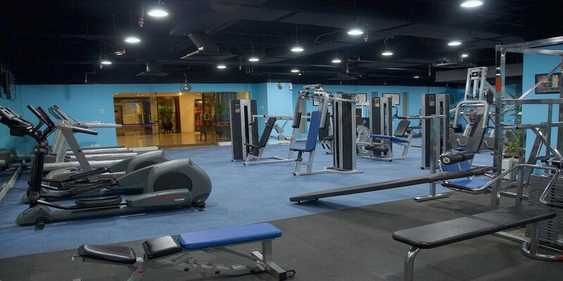 Spacious fitness centre with gym equipment like benches